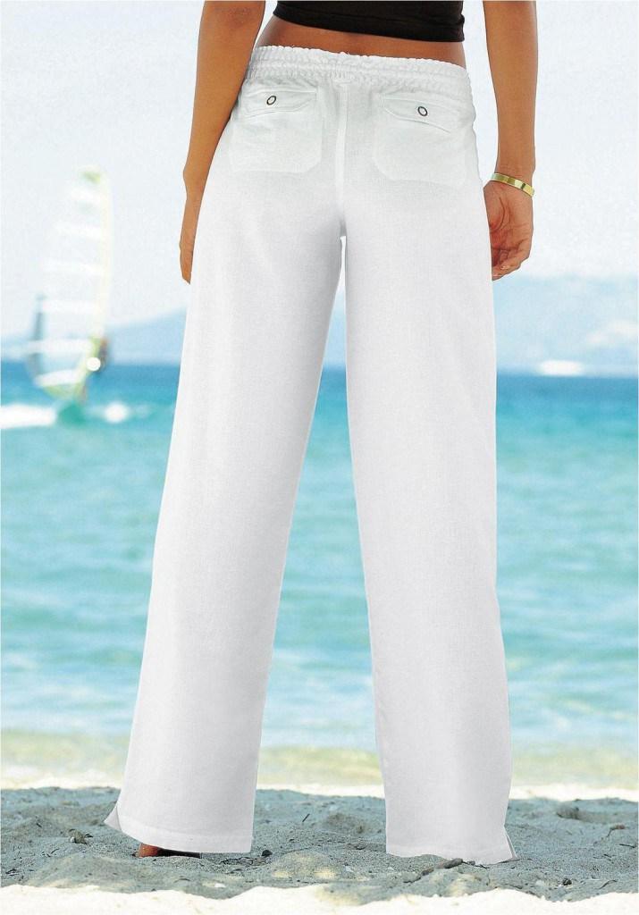 Стильные белые брюки из льна
