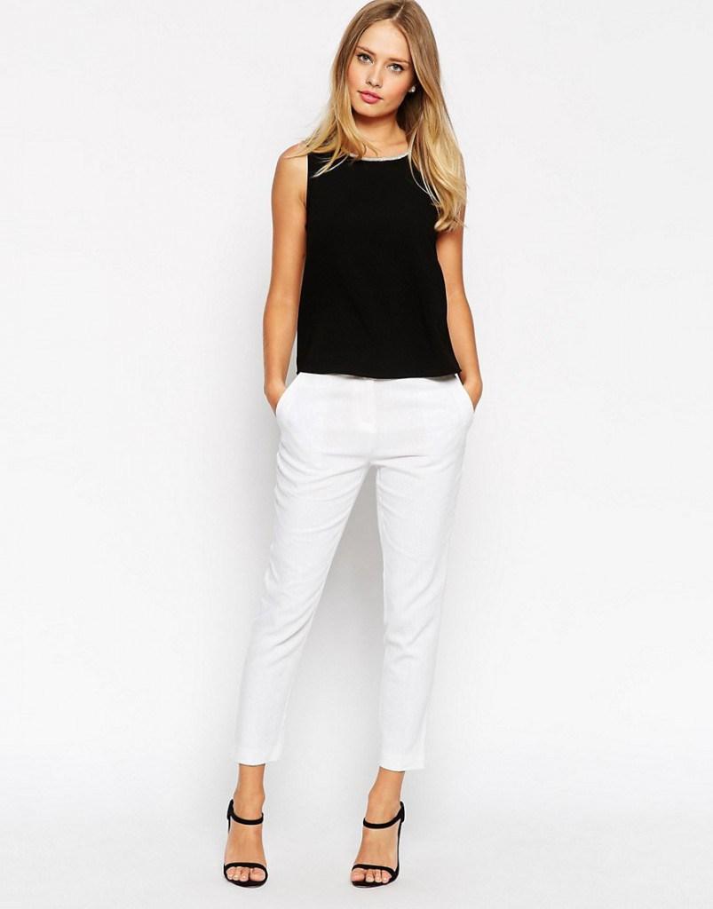 Стильные белые брюки из льна с черной блузой
