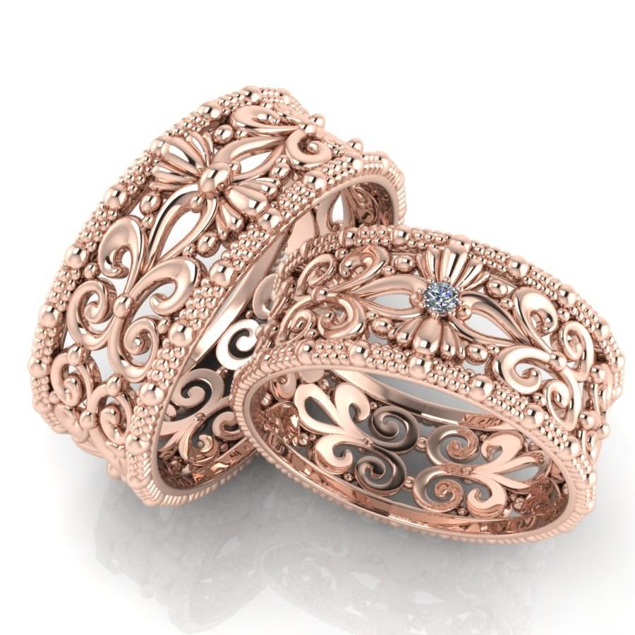 Ажурные обручальные кольца с камнями