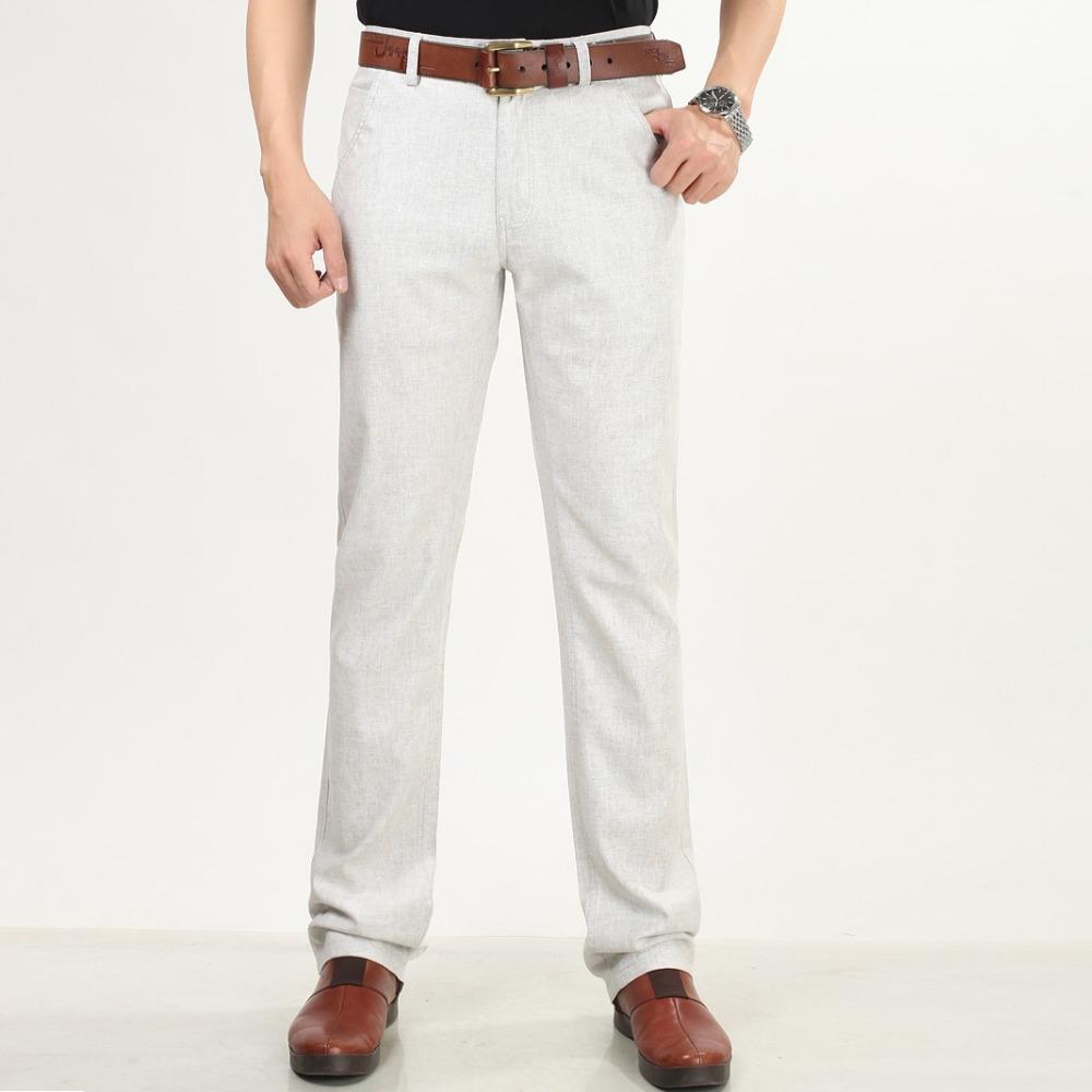 Светло-серые мужские штаны слаксы