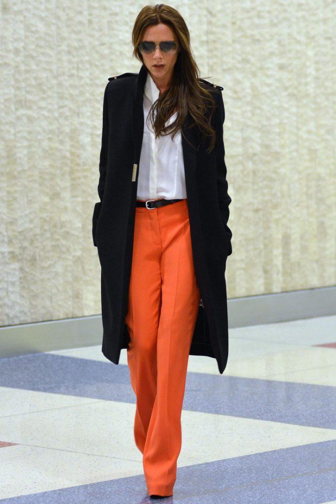 Оранжевый с черным и белым цветами в одежде