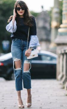 Трендовые джинсы с дырками на коленках: харизма и небрежность в деталях