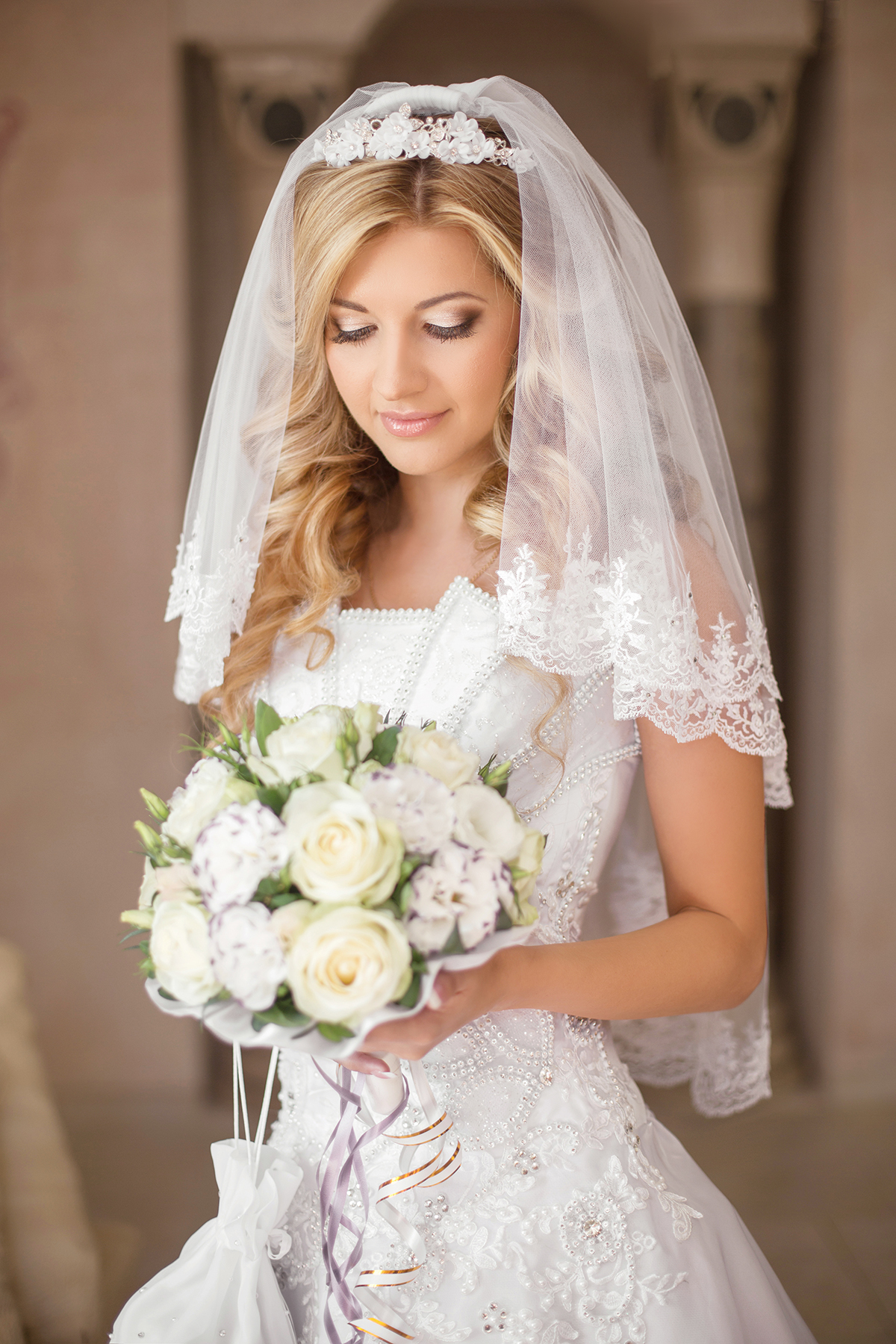 Wedding hairstyles side bun with veil