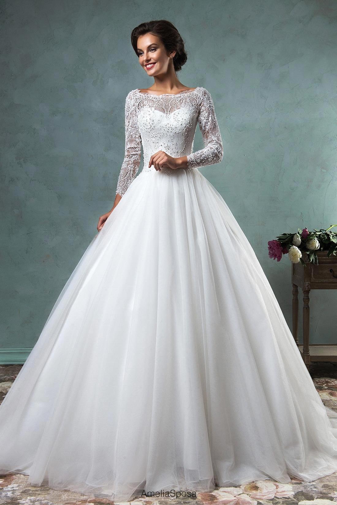 Свадебные платья с рукавами и камнями