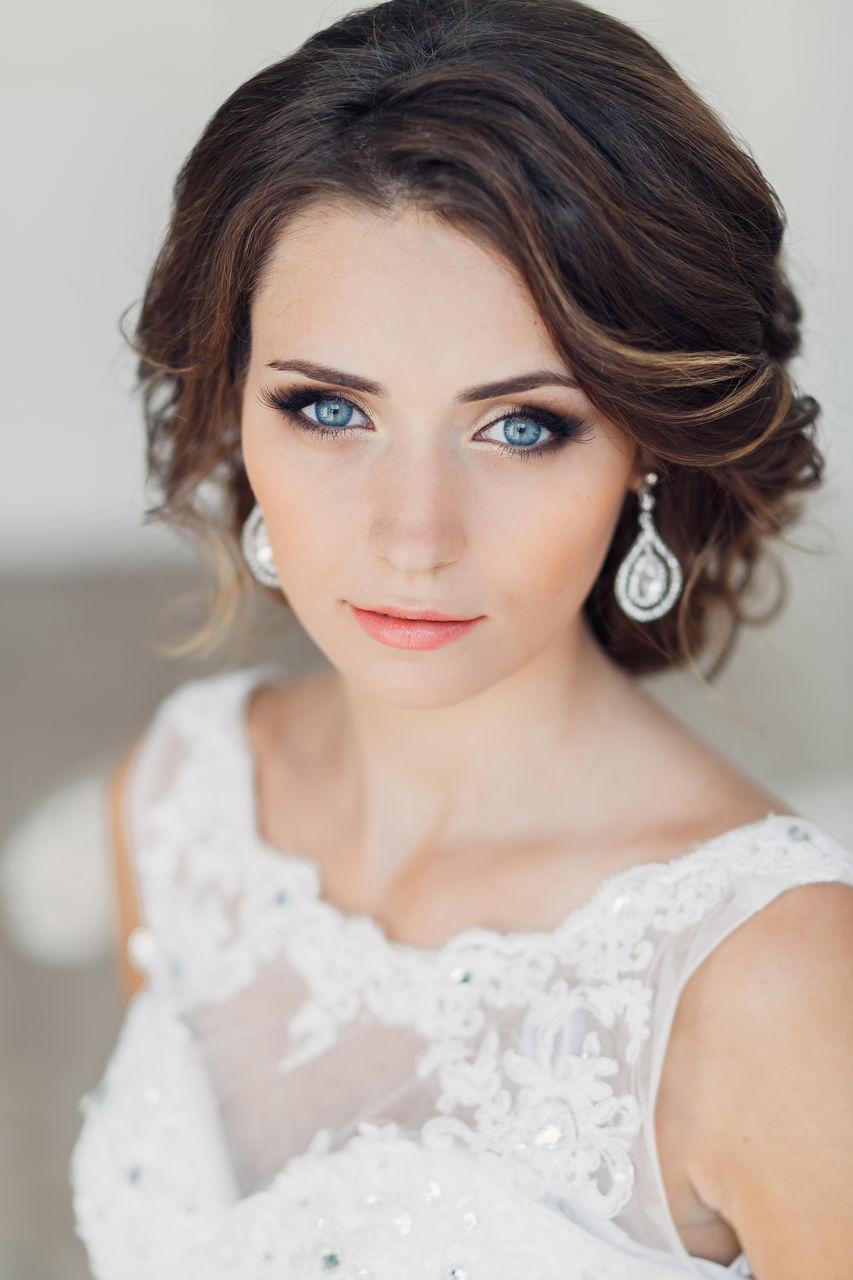 прически на длинные волосы свадебные фото
