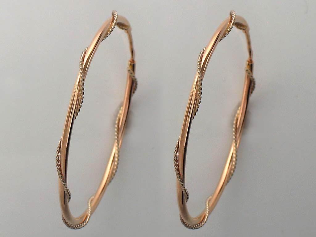 Золотые серьги конго с завитком