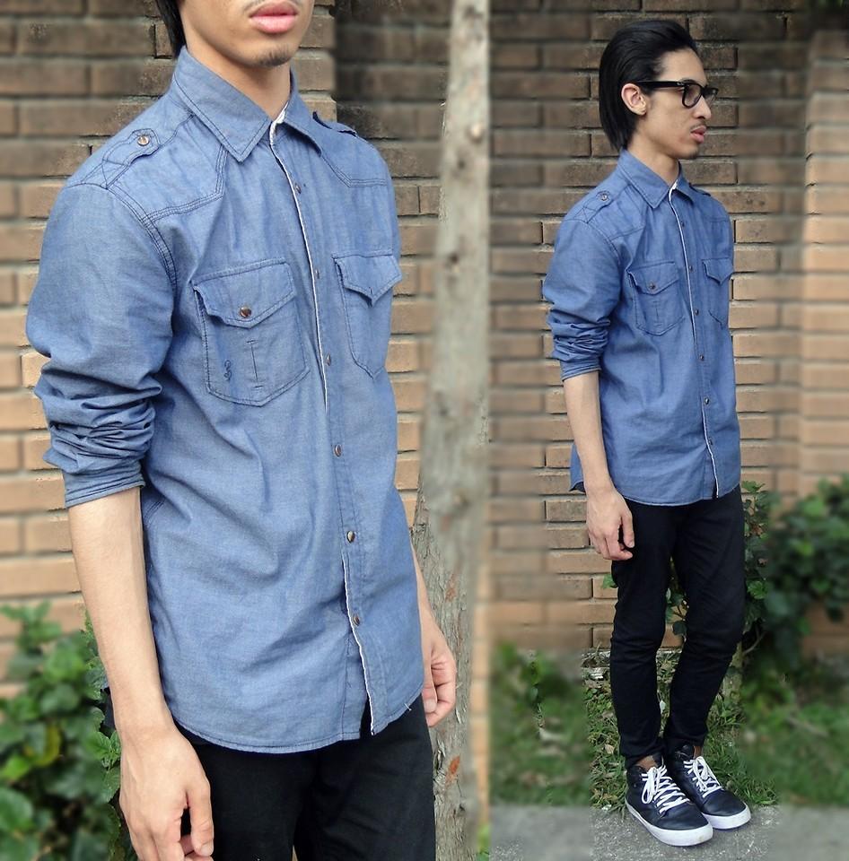 Парень хипстер в очках и джинсовой рубашке
