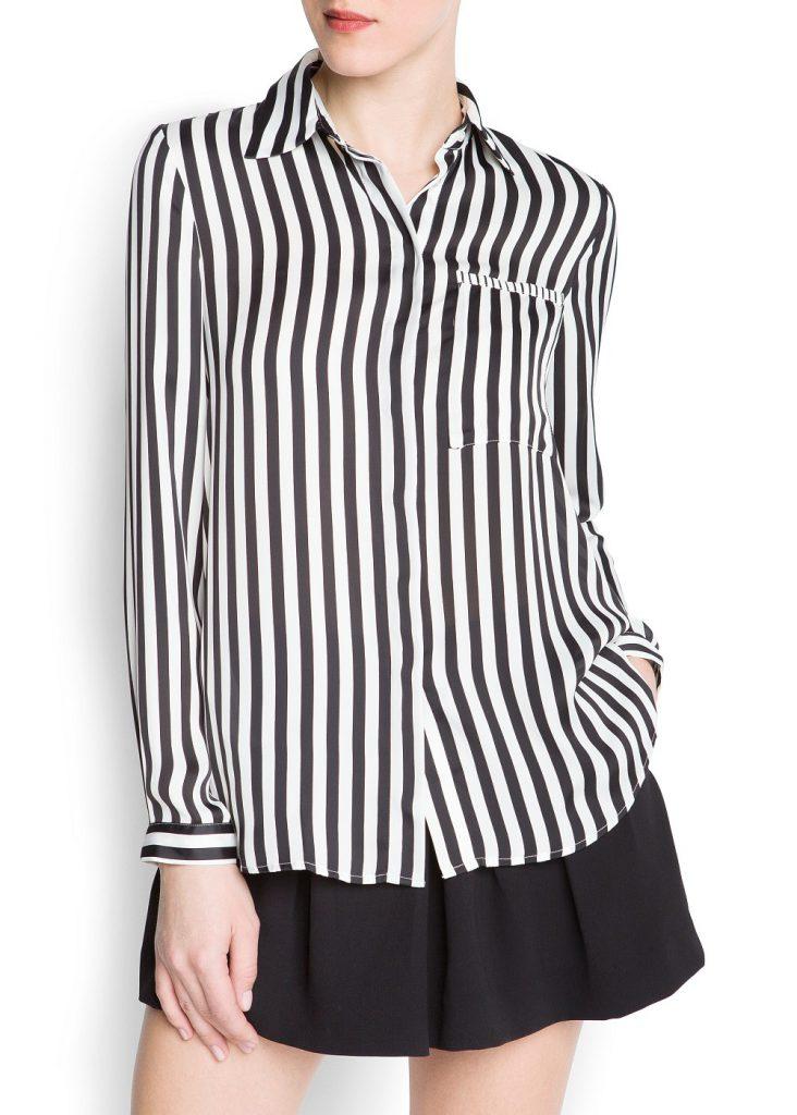 Стильная женская рубашка в полоску с черной юбкой