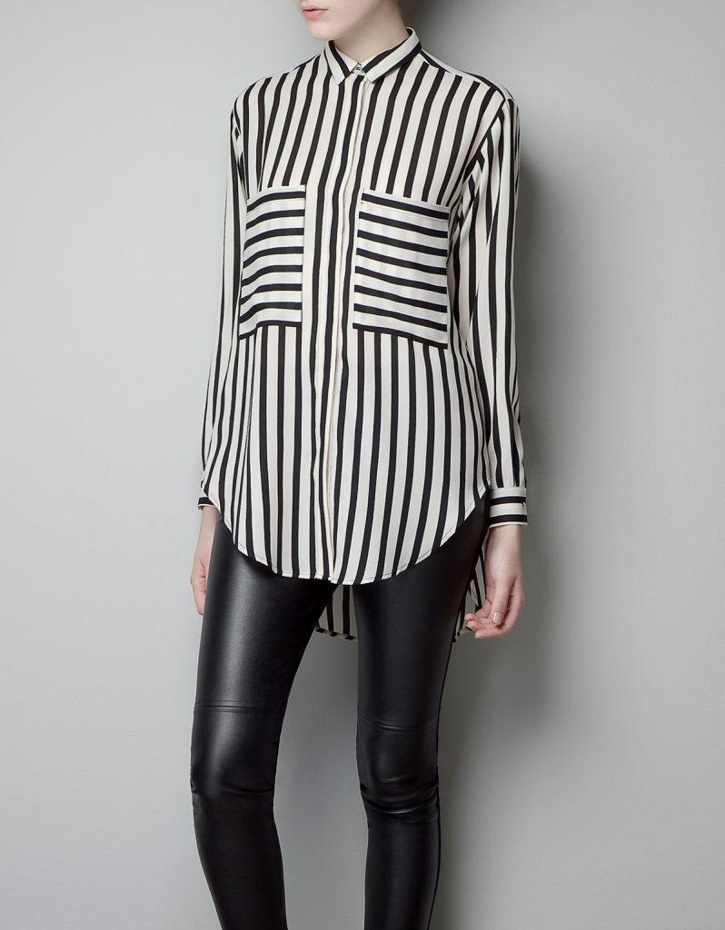 Черно-белая женская рубашка в полоску с кожаными брюками