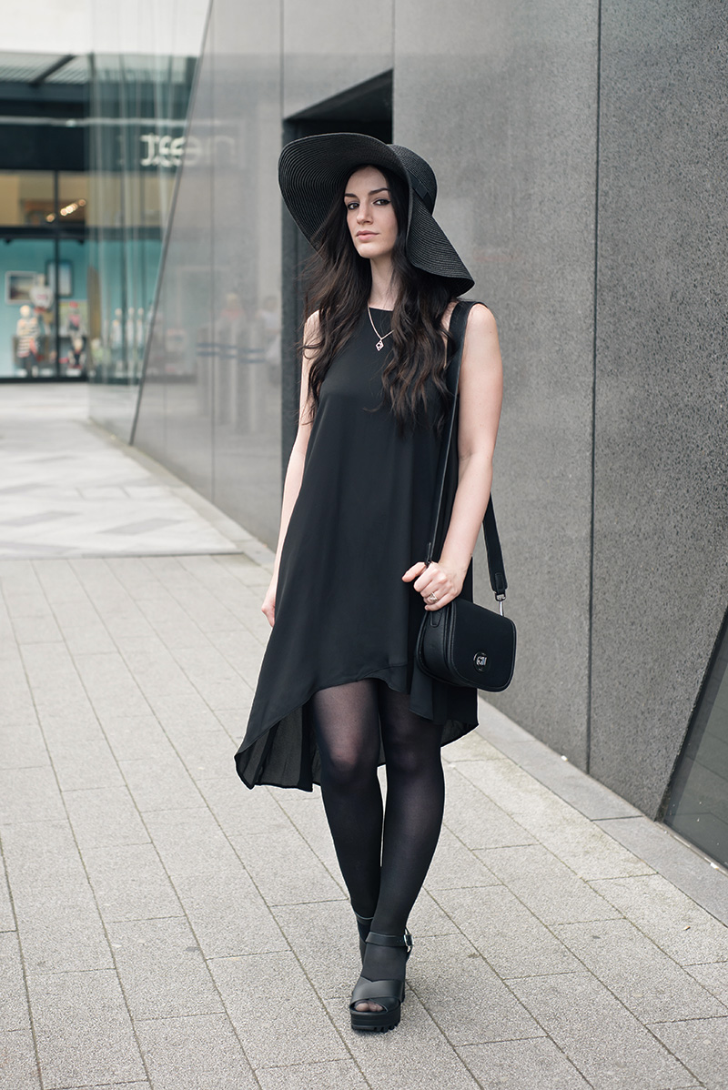 Асимметричная черная шляпа