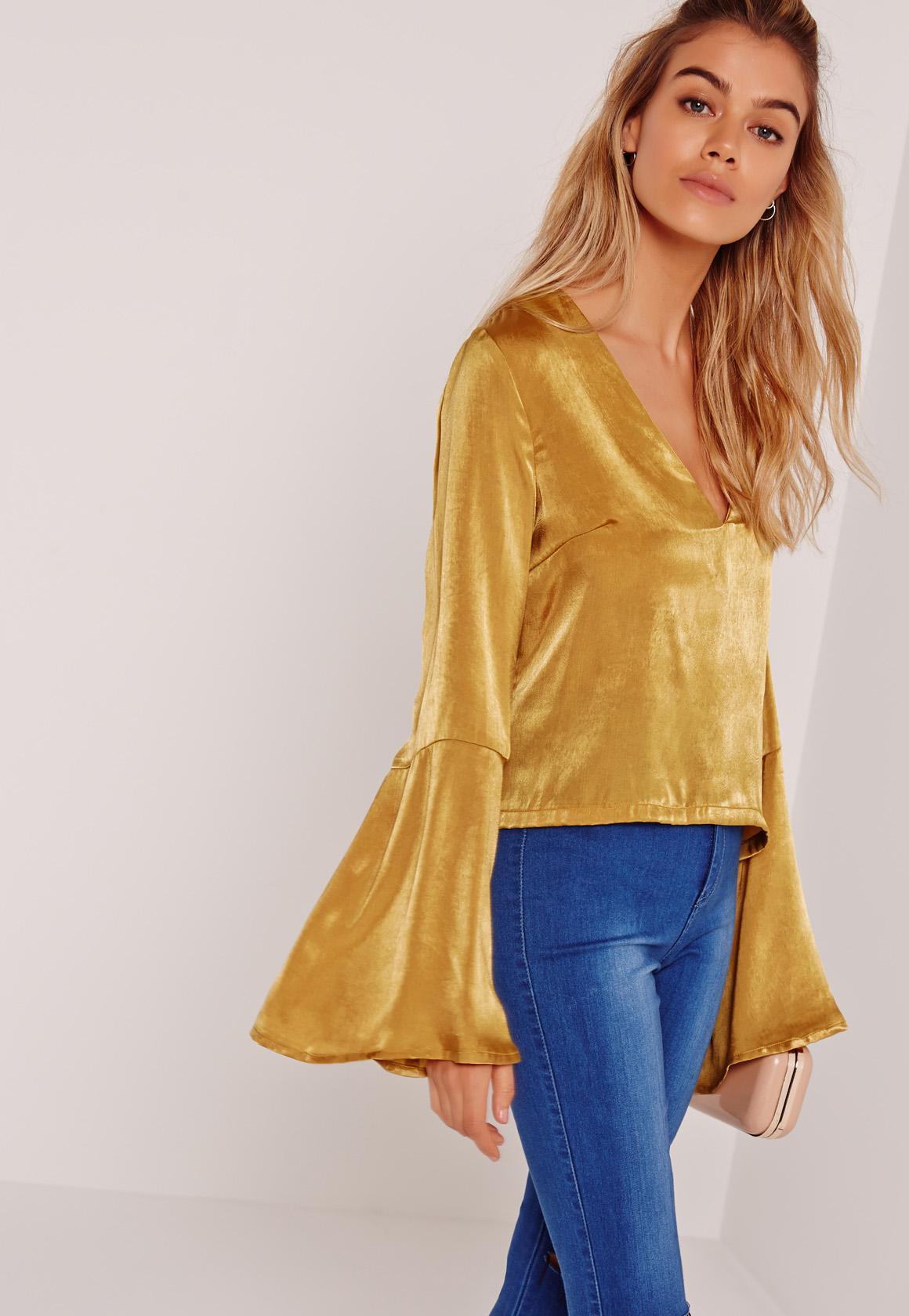 Желтая блузка с широкими рукавами