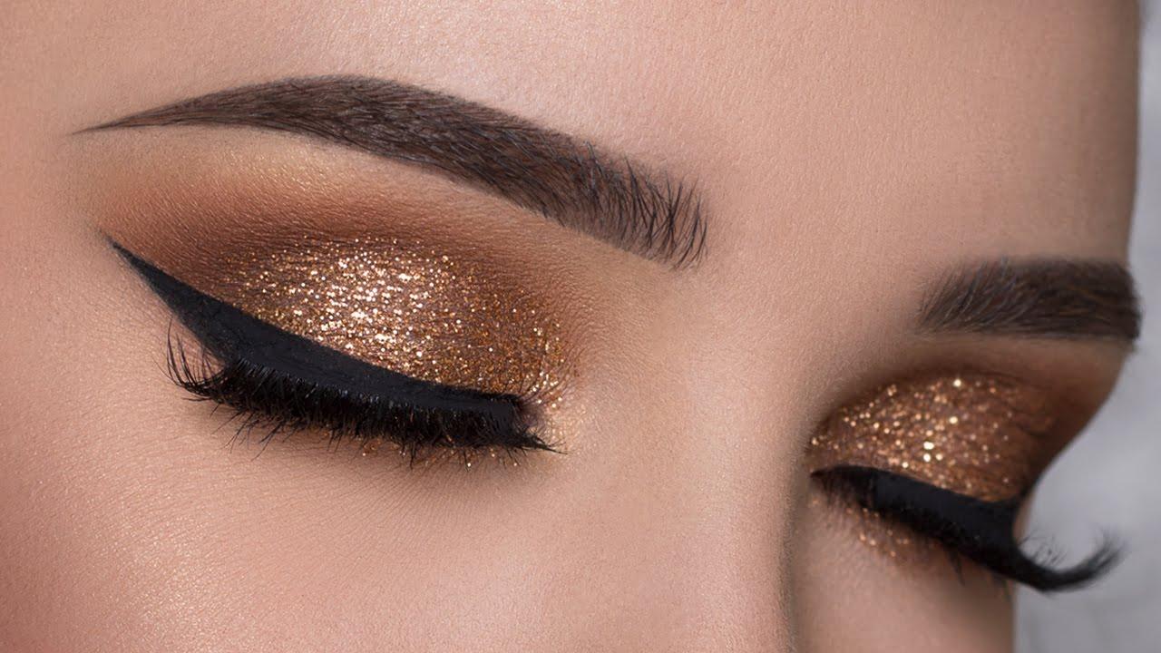Восточный макияж золотой с блестками