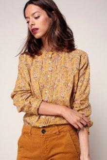 Желтая блузка с рисунком