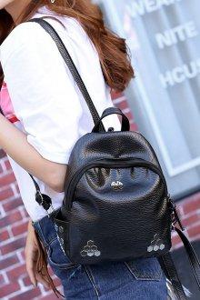 Кожаный рюкзак с металлическим декором