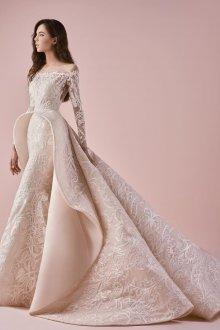 Кружевное свадебное платье сложного кроя