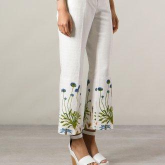 Белые женские брюки с цветочным принтом