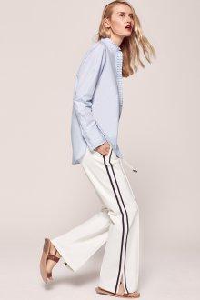 Белые женские брюки с отделкой